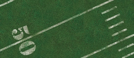 Yard marker lines on a green football field